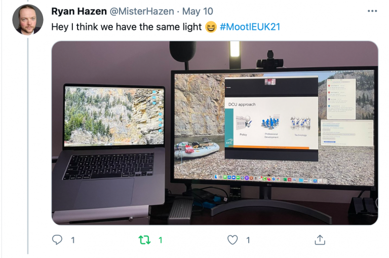 """Screenshot of a tweet from Ryan Hazen @MisterHazen in reply to the previous tweet above that reads: """"Hey I think we have the same light #MootIEUK21"""" attached is a photo of a point of view work desk setup showing a laptop, monitor screen, microphone and lamp on a desk surface."""