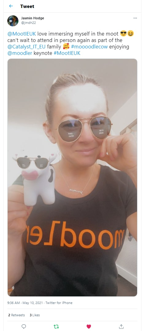 """Screenshot of tweet from Jasmin Hodge @jmdh22 with text reading: """"@MootIEUK love immersing myself in the moot can't wait to attend in person as part of the @Catalyst_IT_EU family #Moooodlecow enjoying @moodler keynote #MootIEUK"""" including a selfie picture attached of user wearing a """"Moodler"""" T-shirt and holding a toy cow figure."""